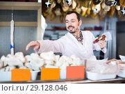 Купить «positive male shop assistant demonstrating sorts of meat in shop», фото № 29128046, снято 2 января 2017 г. (c) Яков Филимонов / Фотобанк Лори