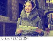 Купить «cheerful girl with map in coat hood», фото № 29128254, снято 11 ноября 2017 г. (c) Яков Филимонов / Фотобанк Лори