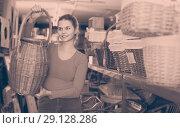 Купить «young woman consumer holding wicker barrel in decor items store», фото № 29128286, снято 13 декабря 2017 г. (c) Яков Филимонов / Фотобанк Лори