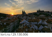 Prague, Czech Republic, September 19, 2018. Beautiful view from above on the city, red roofs of houses, Prague Castle and church in Mala Strana at sunset. Редакционное фото, фотограф Яна Королёва / Фотобанк Лори