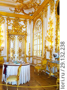 Купить «St. Petersburg. Tsarskoye Selo (Pushkin). The splendor gilded decorations of Chevalier Dining Room interior in typical  Baroque style in the Catherine Palace (Rastrelli, 1752-1756)», фото № 29132238, снято 7 сентября 2018 г. (c) Виктория Катьянова / Фотобанк Лори