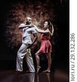 Купить «Young and sexy couple dances Caribbean Salsa», фото № 29132286, снято 22 ноября 2019 г. (c) Игорь Бородин / Фотобанк Лори