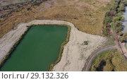 Купить «An artificial lake for fishing. A bridge for fishermen on the lake. Lake fishing.», видеоролик № 29132326, снято 25 июня 2019 г. (c) Леонид Еремейчук / Фотобанк Лори