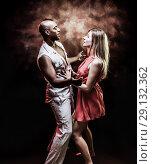 Купить «Young and sexy couple dances Caribbean Salsa», фото № 29132362, снято 22 ноября 2019 г. (c) Игорь Бородин / Фотобанк Лори
