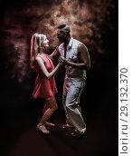 Купить «Young and sexy couple dances Caribbean Salsa», фото № 29132370, снято 22 ноября 2019 г. (c) Игорь Бородин / Фотобанк Лори