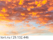 Купить «Abstract background with a texture of clouds at sunset similar to a flame. Heavenly landscape. Beautiful morning sky painted in bright red and orange colors», фото № 29132446, снято 25 сентября 2018 г. (c) Светлана Евграфова / Фотобанк Лори