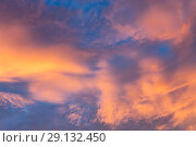 Купить «Abstract background with a texture of clouds at sunset. Heavenly landscape. A beautiful morning blue sky painted in the sun in bright red and orange colors», фото № 29132450, снято 25 сентября 2018 г. (c) Светлана Евграфова / Фотобанк Лори