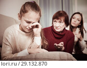 Купить «Little girl crying while mom and granny scolding her», фото № 29132870, снято 25 ноября 2017 г. (c) Яков Филимонов / Фотобанк Лори
