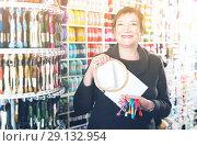Купить «Woman standing with accessories for embroidery in store», фото № 29132954, снято 10 мая 2017 г. (c) Яков Филимонов / Фотобанк Лори