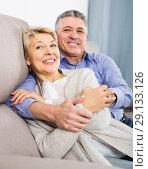 Купить «joyous mature married couple in house are warmly reconciled after quarrel», фото № 29133126, снято 20 октября 2018 г. (c) Яков Филимонов / Фотобанк Лори