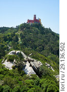 Купить «Pena Palace on the top of Sintra Mountains as seen from the Moorish castle. Sintra. Portugal», фото № 29136502, снято 3 июля 2016 г. (c) Serg Zastavkin / Фотобанк Лори