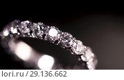 Diamond ring on black background. Стоковое видео, видеограф Сергей Петерман / Фотобанк Лори
