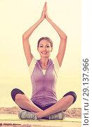 Купить «Young smiling woman practise yoga cross-legged», фото № 29137966, снято 22 октября 2018 г. (c) Яков Филимонов / Фотобанк Лори