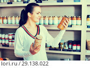 Купить «Woman choosing canned beans in grocery shop», фото № 29138022, снято 23 ноября 2016 г. (c) Яков Филимонов / Фотобанк Лори