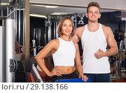 Купить «Portrait of couple standing together in gym indoors», фото № 29138166, снято 4 октября 2016 г. (c) Яков Филимонов / Фотобанк Лори