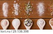 Купить «spoons with salt and spices on wooden table», видеоролик № 29138398, снято 20 сентября 2018 г. (c) Syda Productions / Фотобанк Лори