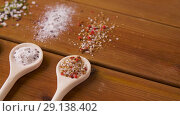 Купить «spoons with salt and spices on wooden table», видеоролик № 29138402, снято 20 сентября 2018 г. (c) Syda Productions / Фотобанк Лори