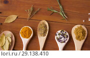 Купить «spoons with different spices on wooden table», видеоролик № 29138410, снято 20 сентября 2018 г. (c) Syda Productions / Фотобанк Лори