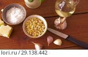 Купить «ingredients for pesto sauce on wooden table», видеоролик № 29138442, снято 20 сентября 2018 г. (c) Syda Productions / Фотобанк Лори