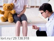 Купить «The doctor checking up young girls reflexes with hammer», фото № 29138918, снято 6 марта 2018 г. (c) Elnur / Фотобанк Лори