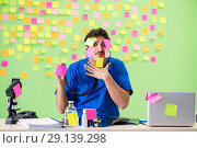 Купить «The young doctor with many reminders and urgent work», фото № 29139298, снято 24 мая 2018 г. (c) Elnur / Фотобанк Лори