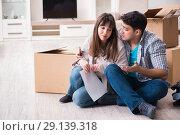 Купить «The young couple receiving foreclosure notice letter», фото № 29139318, снято 23 марта 2018 г. (c) Elnur / Фотобанк Лори