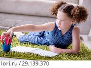 Купить «The young little girl drawing on paper with pencils», фото № 29139370, снято 24 июня 2017 г. (c) Elnur / Фотобанк Лори