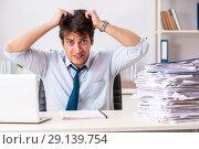 Купить «The overloaded busy employee with too much work and paperwork», фото № 29139754, снято 3 июля 2018 г. (c) Elnur / Фотобанк Лори