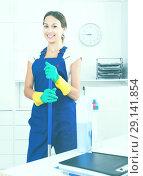 Купить «Woman cleaning at company office», фото № 29141854, снято 19 декабря 2018 г. (c) Яков Филимонов / Фотобанк Лори