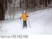 Купить «Young sportive girl running on skies in winter road in forest, full-length, copys pace», фото № 29142166, снято 21 января 2018 г. (c) Кекяляйнен Андрей / Фотобанк Лори