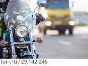 Купить «Мотоцикл едет по дороге с выключенной фарой, пере грузовым автомобилем», фото № 29142246, снято 15 сентября 2018 г. (c) Кекяляйнен Андрей / Фотобанк Лори