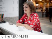 Купить «Beautiful girl with bob haircut sitting pensively at a cafe», фото № 29144818, снято 27 сентября 2018 г. (c) Константин Шишкин / Фотобанк Лори