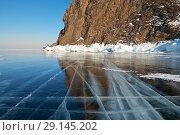 Купить «Beautiful winter landscape of the frozen Lake Baikal with mirror blue ice near the coastal rocks of Olkhon Island at sunset», фото № 29145202, снято 6 марта 2011 г. (c) Виктория Катьянова / Фотобанк Лори