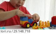 Купить «Closeup childs hands play colorful plastic bricks», видеоролик № 29148718, снято 29 сентября 2018 г. (c) Ekaterina Demidova / Фотобанк Лори