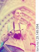 Купить «Young girl is leafing through the booklet», фото № 29149094, снято 4 мая 2017 г. (c) Яков Филимонов / Фотобанк Лори