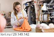 Купить «Smiling woman professional working with material at atelier», фото № 29149142, снято 5 мая 2018 г. (c) Яков Филимонов / Фотобанк Лори