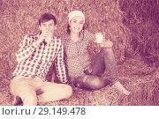 Купить «couple in the hay with milk», фото № 29149478, снято 18 апреля 2019 г. (c) Яков Филимонов / Фотобанк Лори