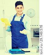 Купить «Man cleaner 28-33 years old is ready to clean the cabinet», фото № 29149578, снято 18 мая 2017 г. (c) Яков Филимонов / Фотобанк Лори