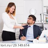 Купить «Sexual harassment between colleagues», фото № 29149614, снято 1 июня 2017 г. (c) Яков Филимонов / Фотобанк Лори