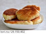 Купить «A plate of the delicious fried pies», фото № 29150402, снято 16 сентября 2018 г. (c) Володина Ольга / Фотобанк Лори