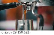 Купить «Espresso pouring from coffee machine. Middle roasted.», видеоролик № 29150622, снято 17 октября 2018 г. (c) Константин Шишкин / Фотобанк Лори