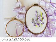 Купить «Hand embroidery with satin ribbons on a white canvas of gladiolus flowers in a gently purple tinged (These pictures of embroidery and embroidery with satin ribbons were performed by the author of the images)», фото № 29150686, снято 24 сентября 2018 г. (c) Виктория Катьянова / Фотобанк Лори