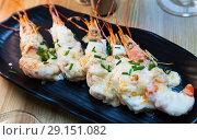 Купить «Baked tasty prawns with parmesan cheese and greens at plate», фото № 29151082, снято 27 мая 2019 г. (c) Яков Филимонов / Фотобанк Лори