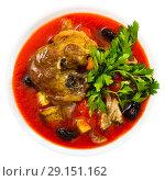Купить «Top view of spicy tomato soup with lamb, prunes, dried apricots», фото № 29151162, снято 16 августа 2018 г. (c) Яков Филимонов / Фотобанк Лори