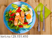 Купить «Tasty breakfast with trout, egg, pepper and lettuce at plate on table», фото № 29151410, снято 1 июня 2020 г. (c) Яков Филимонов / Фотобанк Лори
