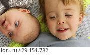 Children funny portrait little brother and sister cheek to cheek. Стоковое видео, видеограф Ekaterina Demidova / Фотобанк Лори