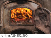 Купить «Fire wood in ancient rust stove.», фото № 29152390, снято 23 августа 2018 г. (c) easy Fotostock / Фотобанк Лори