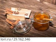 Купить «Food, sweet dessert. Homemade canning. A jar of fruit peach jam with cinnamon on the background of a wooden table in a rustic style», фото № 29162346, снято 9 сентября 2018 г. (c) Светлана Евграфова / Фотобанк Лори