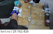 Купить «Нарезка разных сортов сыра для презентации», видеоролик № 29162426, снято 21 апреля 2019 г. (c) Евгений Ткачёв / Фотобанк Лори