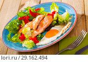 Купить «Tasty breakfast with trout, egg, pepper and lettuce at plate on table», фото № 29162494, снято 22 октября 2018 г. (c) Яков Филимонов / Фотобанк Лори